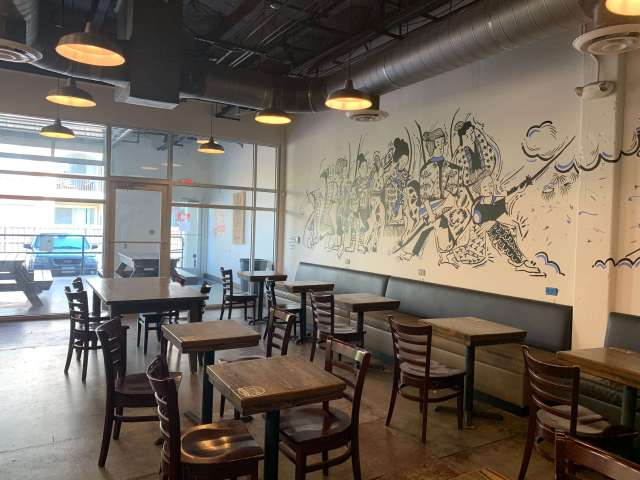 Mural and seating at Avoca Coffee Roasters in West 7th Cultural District, Fort Worth, Texas